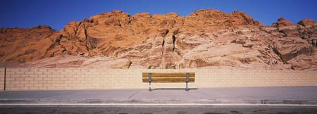 Bench in front of rocks