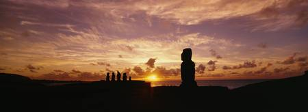 Silhouette of Moai statues at dusk