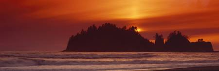 Silhouette of sea stack at sunrise Washington Sta
