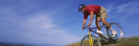 Low angle view of a man mountain biking