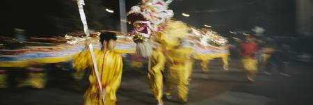 Group of people performing a dragon dance