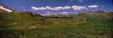 Grassland with a mountain range in the background