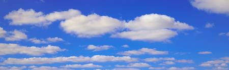 Puffy white clouds against bright blue sky