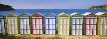 Beach huts in a row on the beach