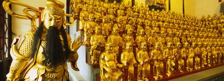 Golden statues in a temple