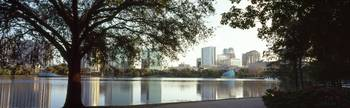 Buildings at the waterfront Lake Eola Orlando Ora