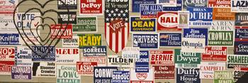 Close-up of election posters on a wall