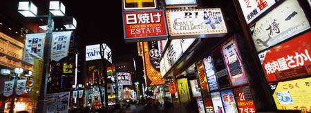 Commercial signboards lit up at night in a market