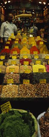 Two vendors standing in a spice store
