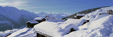 Snow Covered Chapel and Chalets Swiss Alps Switze