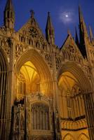 Moon over Peterborough Cathedral illuminated at n