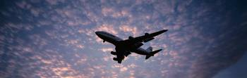 Boeing 747 airplane in flight against evening clo