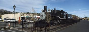 Steam engine on display outside a railroad depot