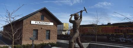 Statue in front of a railroad depot