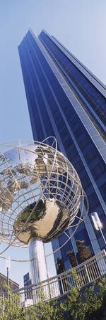 Low angle view of a Globe sculpture near a skyscr
