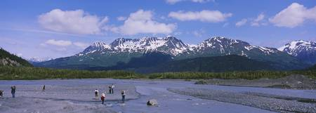Tourists at the water runoff of Exit Glacier