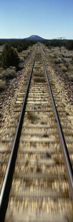 Railroad tracks passing through a landscape