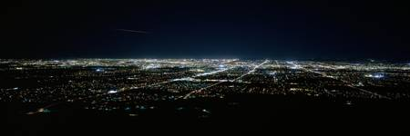 Aerial view of a city lit up at night