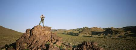 Man standing on the top of a rock