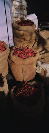 High angle view of red chilies in burlap