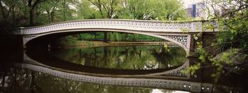 Arch bridge across a lake Central Park Manhattan