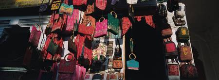 Low angle view of purses hanging in a store