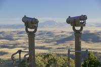 Close-up of two telescopes at an observatory