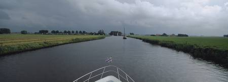Boat on Canal Friesland Netherlands