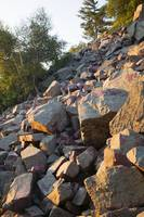 Quartzite rock boulders on hillside