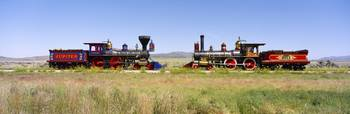 Two steam engines on a railroad track