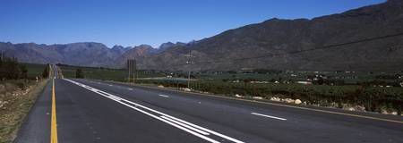 Highway with a mountain range in the background