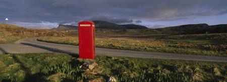 Telephone booth in a landscape