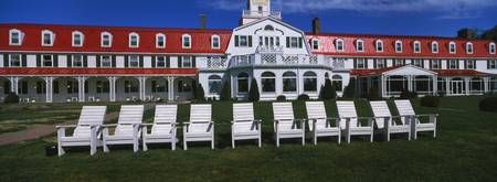 Adirondack chairs in front of a hotel