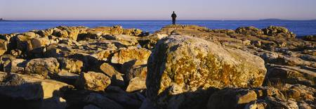 Silhouette of a man standing on a rock