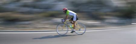 Bike racer participating in a bicycle race Sitges