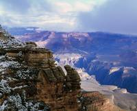 View of snow and storm clouds over Grand Canyon f
