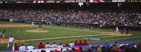 Spectators watching baseball game in a baseball s