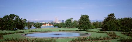 Formal garden in City Park with city and Mount Ev