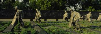 Statues of army soldiers in a park