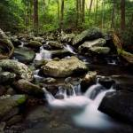 """Water cascading over rocks"" by Panoramic_Images"