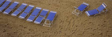High angle view of lounge chairs on the beach