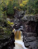 Waterfall and black cliffs along Temperance River