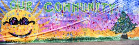 Close-up of a hand painted community banner
