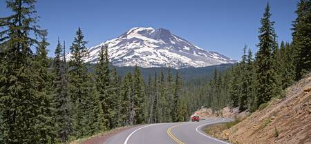 Vehicle moving on a road with South Sister Mounta