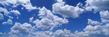 Fluffy Clouds in Fair Weather Sky