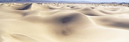 Panoramic view of sand dunes on a landscape