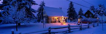 Log House with Christmas Lights Laurentians Canad