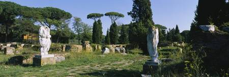 Ruins of statues in a garden