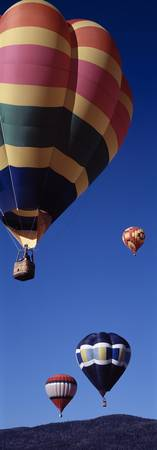 Low angle view of hot air balloons flying in the