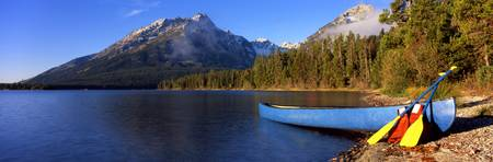 Canoe in lake in front of mountains